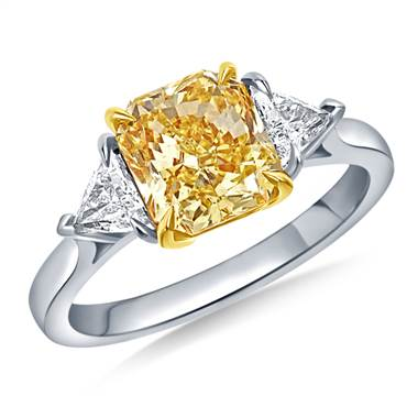 Fancy intense yellow radiant three stone ring with trillion cut side stones set in platinum at B2C Jewels