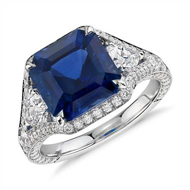 Emerald-cut sapphire and diamond halo ring set in 18K white gold at Blue Nile