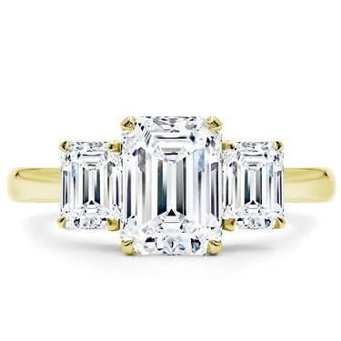 Emerald cut three stone engagement ring setting at Adiamor