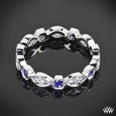 18k white gold odyssey diamond and blue sapphire right hand ring.