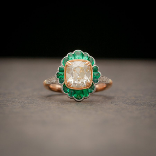 AVC diamond ring with emerald halo.