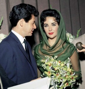 Elizabeth Taylor wearing the diamond heart pendant necklace at her wedding to Eddie Fisher in 1959.