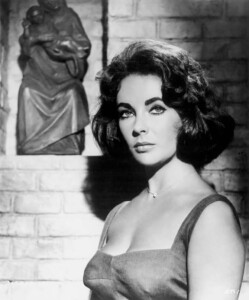 """Elizabeth Taylor wearing the diamond heart pendant necklace on the set of """"Suddenly Last Summer"""" in 1959."""