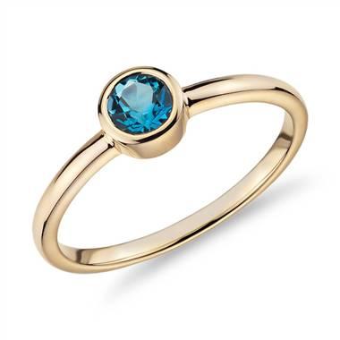 Petite bezel-set Swiss blue topaz fashion ring set in 14K yellow gold at Blue Nile