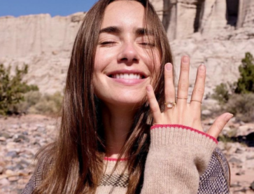 Close up image of American actress Lily Collins and her Rose cut engagement ring.