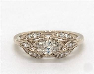 A floral marquise-shape milgrain engagement ring set in 14K yellow gold at James Allen.