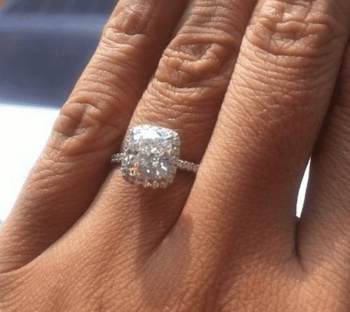 Harry Winston halo diamond engagement ring.