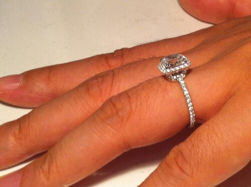 Side view of a halo diamond engagement ring designed by Harry Winston.