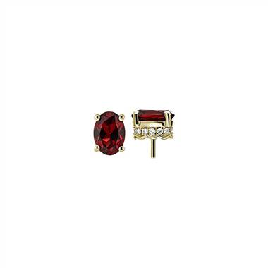 A pair of oval red garnet and diamond earrings set in 14K yellow gold at Blue Nile.