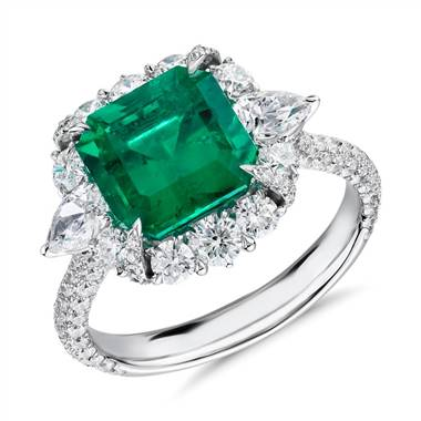 For inspiration: emerald-cut emerald and diamond pear-shaped halo ring set in 18K white gold at Blue Nile