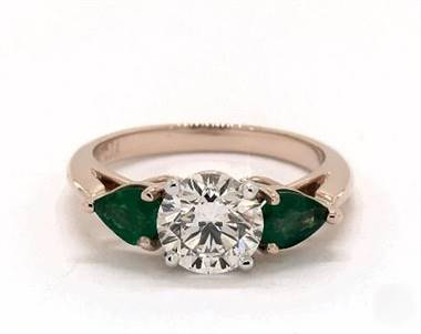A Pear-Emerald 3-Stone Engagement Ring set in 14K Rose Gold.