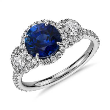 A Sapphire and Diamond Halo 3-Stone Ring set in 18K White Gold.