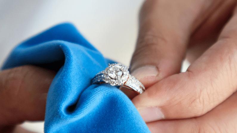 A man polishing a diamond ring.
