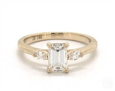 A 3-Stone Marquise Diamond Engagement Ring set in 14K Yellow Gold.