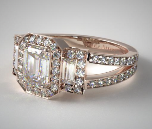 An Emerald Cut 3-Stone Split Shank Engagement Ring in 14K Rose Gold.