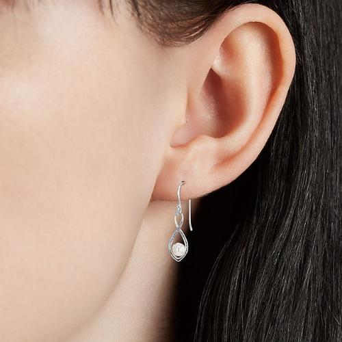 Freshwater Cultured Pearl Twisted Teardrop Earrings in Sterling Silver.
