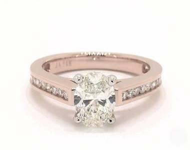 A Delicate Channel-Set Engagement Ring set in 14K Rose Gold.