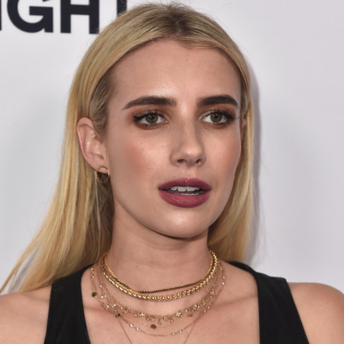 Emma Roberts wearing a Layered Gold Necklace.