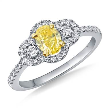 A Fancy Intense Yellow Oval Cut Diamond Halo Ring crafted in 18K two-tone Gold.