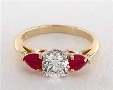 hree-Stone Pear-Ruby Engagement Ring in 18K Yellow Gold Band.