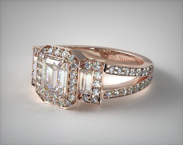 A 14K Rose Gold Emerald Three Stone Engagement Ring.