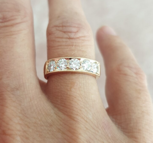 ROSE GOLD AND DIAMOND FIVE-STONE RESET