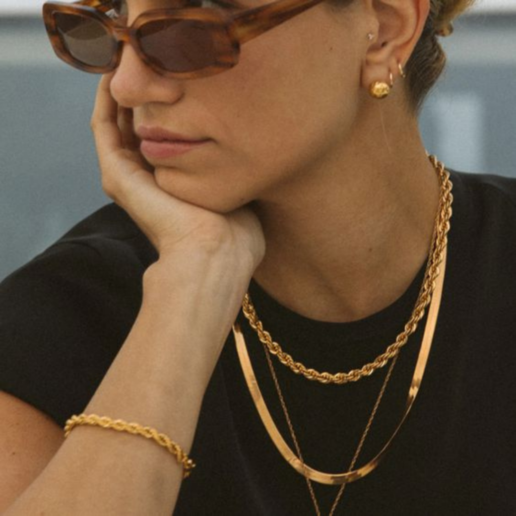 Basic gold plated stacked jewelry.