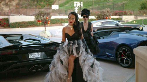 Kelly Mi Li in a fabulous dress in front of high end cars (lamborghini)