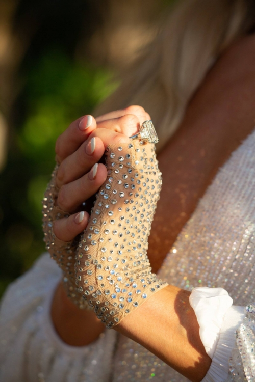 clasped hands, lace and crystal fingerless gloses and the engament ring profile.