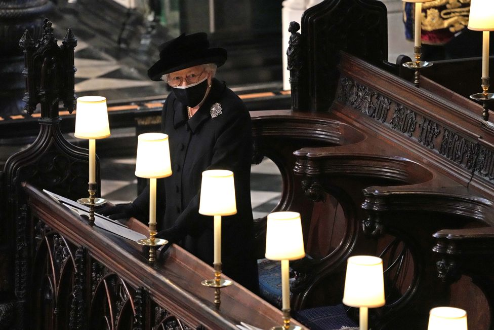 Queen Elizabeth II standing alone at her husband's socially distanced funeral
