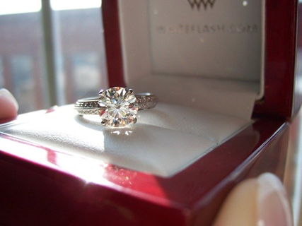 Diamond engagement ring in a red and white ring box