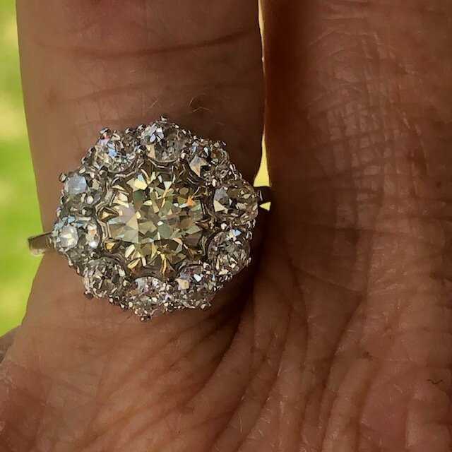 Diamond daisy cluster ring.