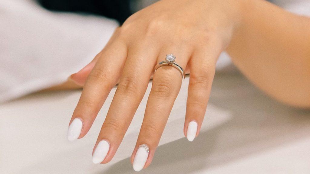 diamond on manicured hand