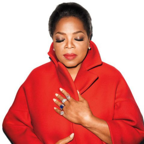 Oprah Winfrey headshot wearing a red coat and cocktail rings.