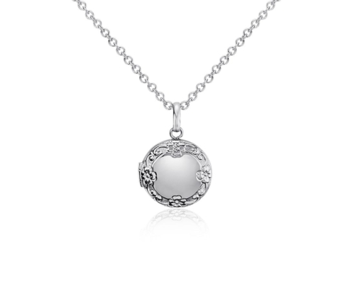 a small silver locket on a delicate chain