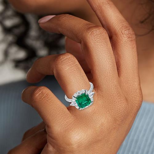 Emerald-Cut Emerald and Diamond Pear-Shaped Halo Ring in 18k White Gold.