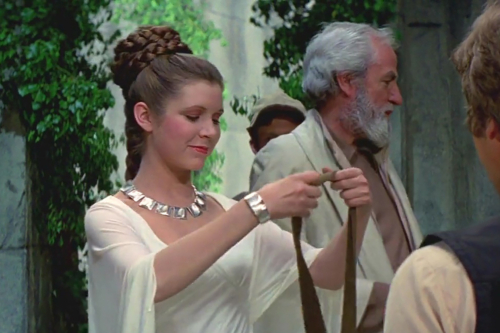 Princess Leia awarding a medal to Han Solo wearing the silver necklace and bracelet