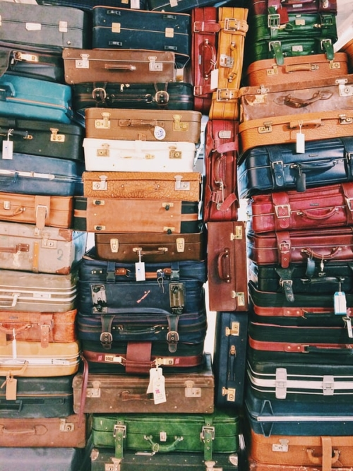 stacks of colorful suitcases