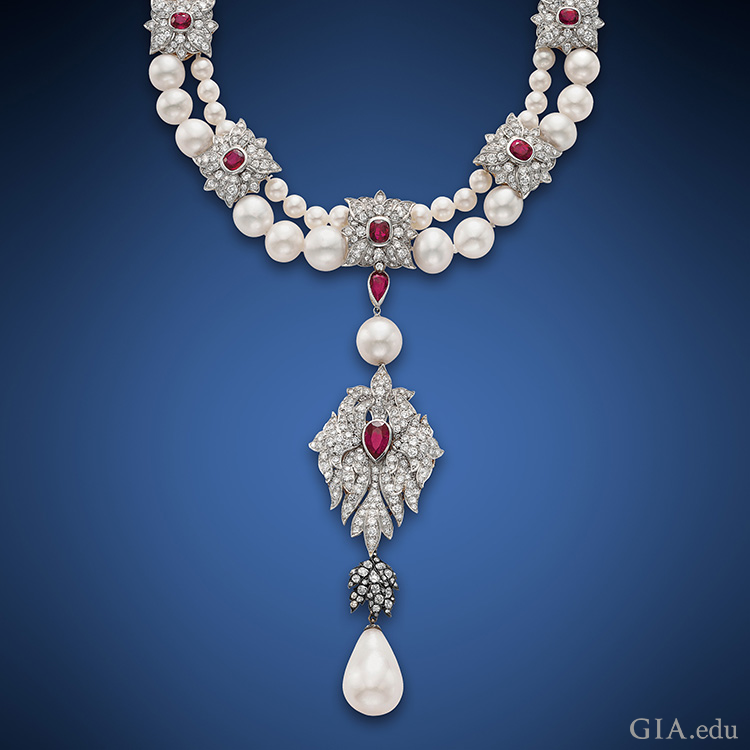 Cartier set Elizabeth Taylor's historic 50.56 ct La Peregrina pearl as part of the pendant to this two-strand pearl, ruby and diamond necklace.