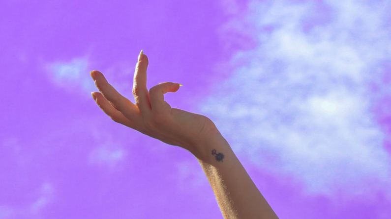 Hand touching sky