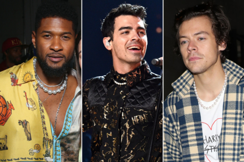 Usher in a yellow button down shirt with the top buttons open to expose a pearl necklace, Joe Jonas in a black lace top with a pearl necklace, and Harry Styles in a plaid jacket and a white graphic tee with a pearl necklace