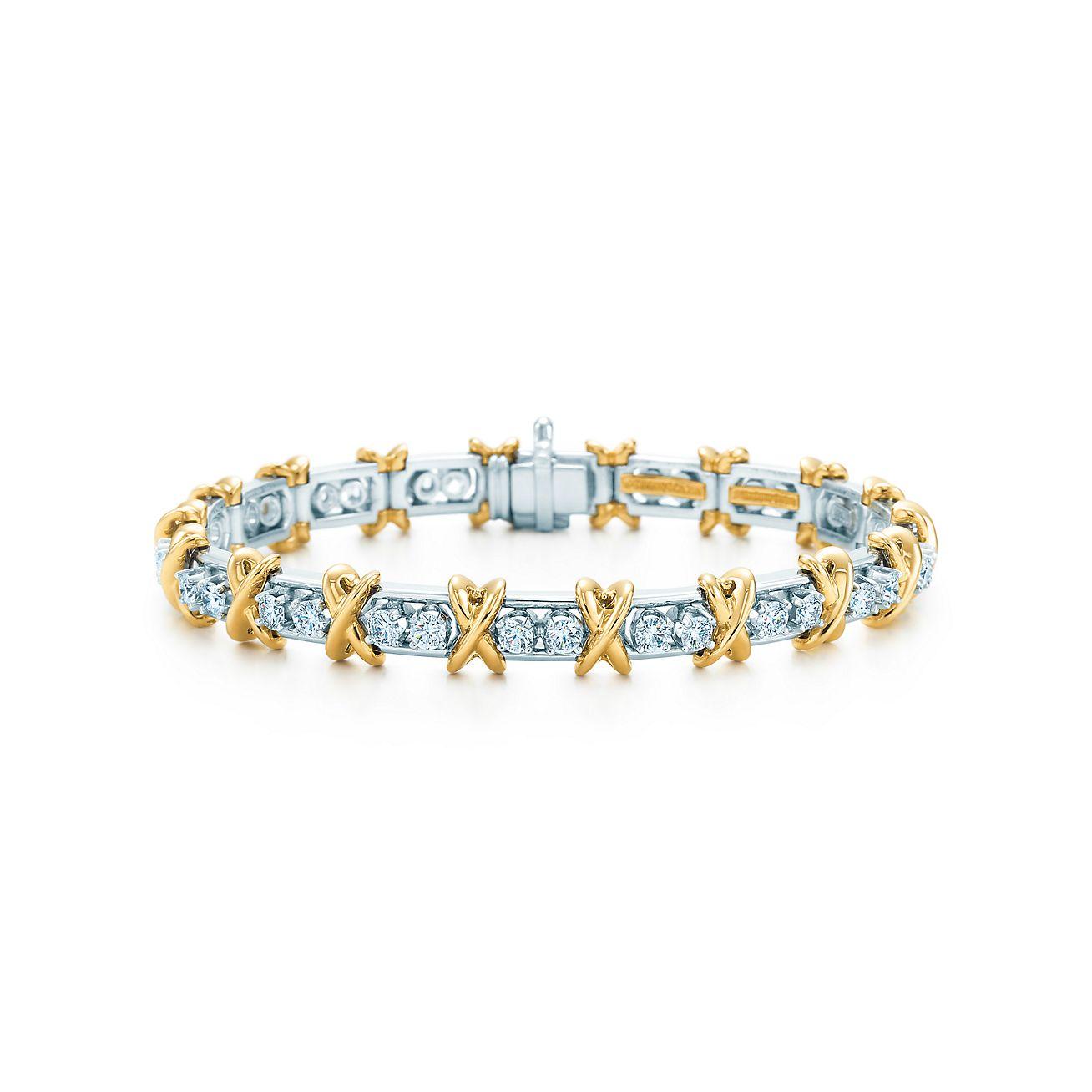 36 Stone Bracelet in 18k gold and platinum with round brilliant diamonds.