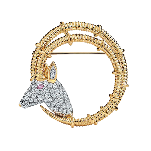 Ibex Brooch in 18k yellow gold and platinum with diamonds.