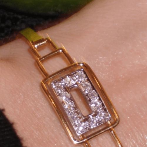 gold and diamond art deco bracelet on a wrist
