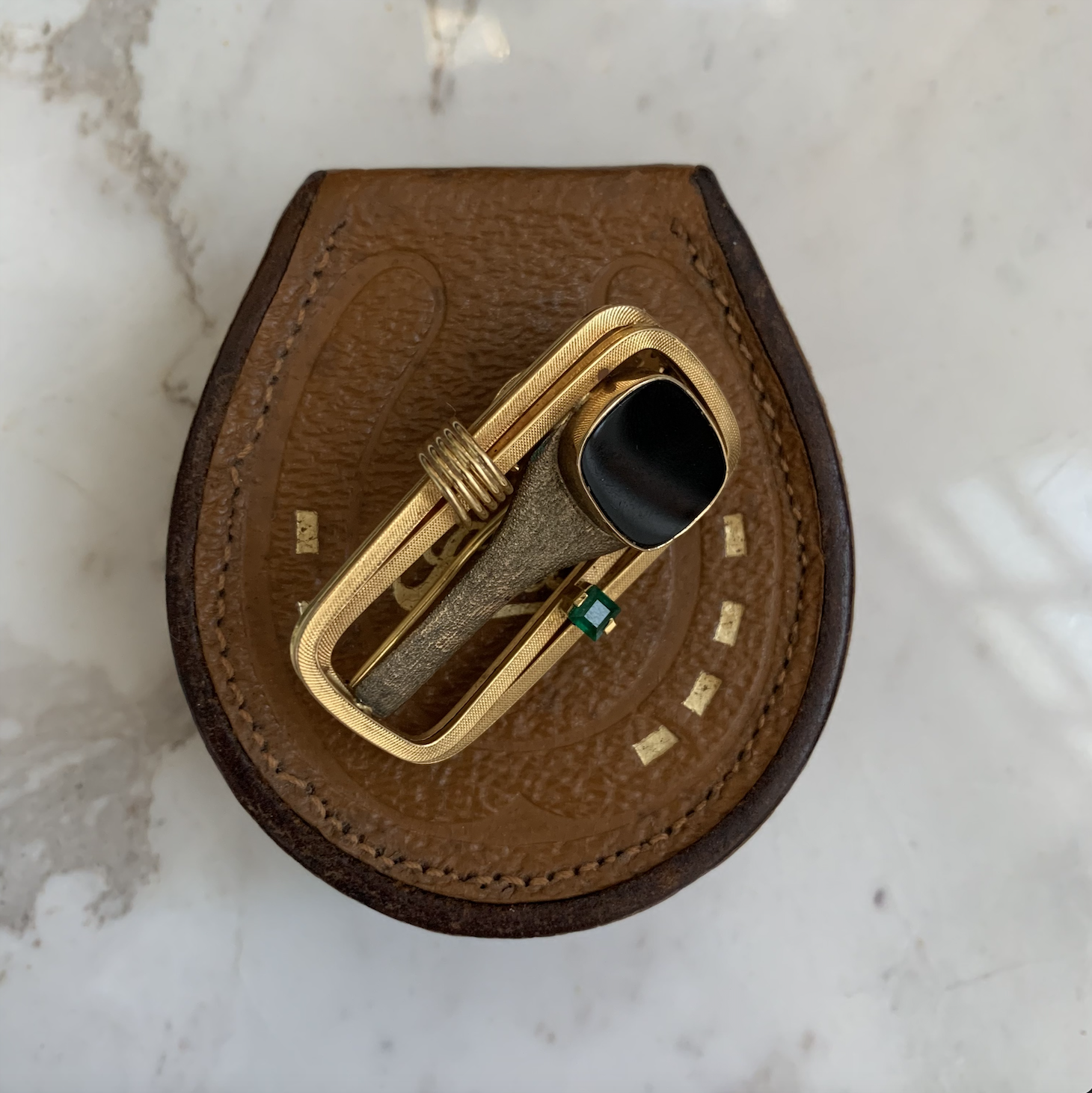 Gold signet ring with onyx brooch.