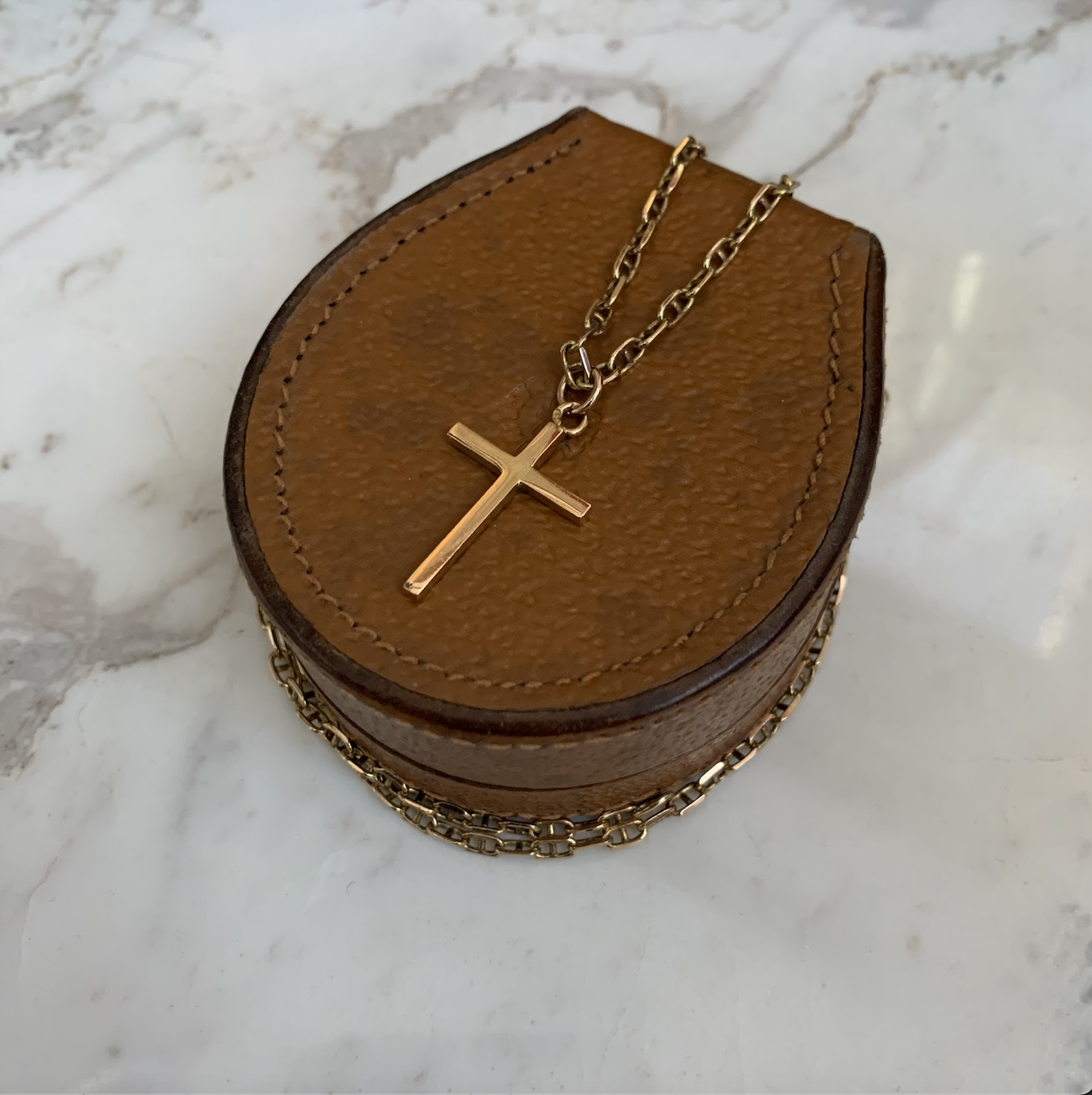 Gold cross necklace.