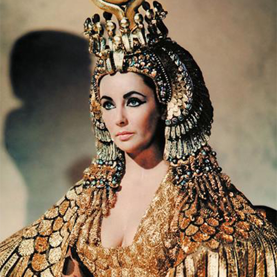 Cleopatra, the actress, wearing peridot gemstones in her head jewels.