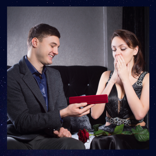 a man gifting a woman with a jewelry box.
